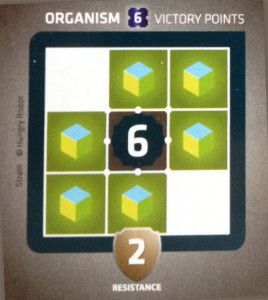An organism card which needs six tiles around it to score six victory points.