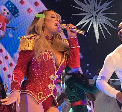 Mariah singing, wearing a nutcracker inspired costume