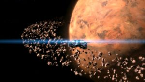 Screen grab of JULIA Among the Stars, a ship headed toward an orange planet surrounded by rocks field