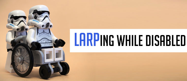 LARPing while Disabled. Two Storm Troopers, one in a wheelchair being pushed by the other